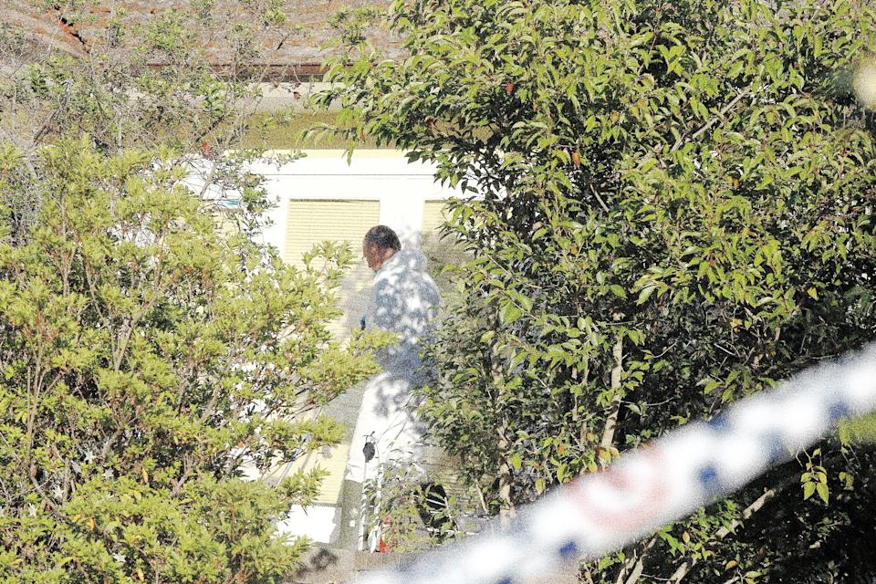 A cleaner is seen at a property in West Pennant Hills, Sydney, Saturday, July 7, 2018.