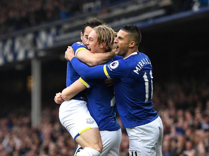 Tom Davies celebrates after opening the scoring for Everton after just 30 seconds: Getty