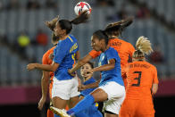 Brazil and Netherlands players battle for a header during a women's soccer match at the 2020 Summer Olympics, Saturday, July 24, 2021, in Miyagi, Japan. (AP Photo/Andre Penner)