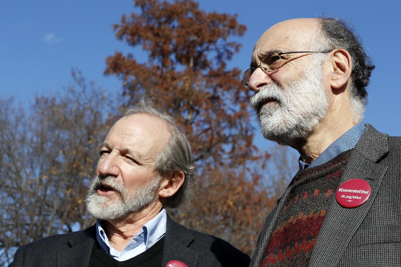 CORRECTS THAT THEY ARE SEEKING AN EXONERATION NOT A PARDON - Michael, left, and Robert Meeropol, the sons of Ethel Rosenberg, speak to the media after they attempted to deliver a letter to President Barack Obama in an effort to obtain a exoneration for their mother Ethel Rosenberg, in front of the White House, Thursday, Dec. 1, 2016 in Washington. Ethel Rosenberg was executed, along with her husband, Julius, in 1953 after being convicted in a Cold War atomic spying case that captivated the country. (AP Photo/Alex Brandon)