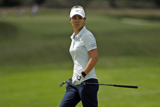 Danielle Kang looks over her putt on the seventh green during the first round of the LPGA Drive On Championship golf tournament at Inverness Golf Club in Toledo, Ohio, Friday, July 31, 2020. Kang finished in the early lead at six-under par. (AP Photo/Gene J. Puskar)