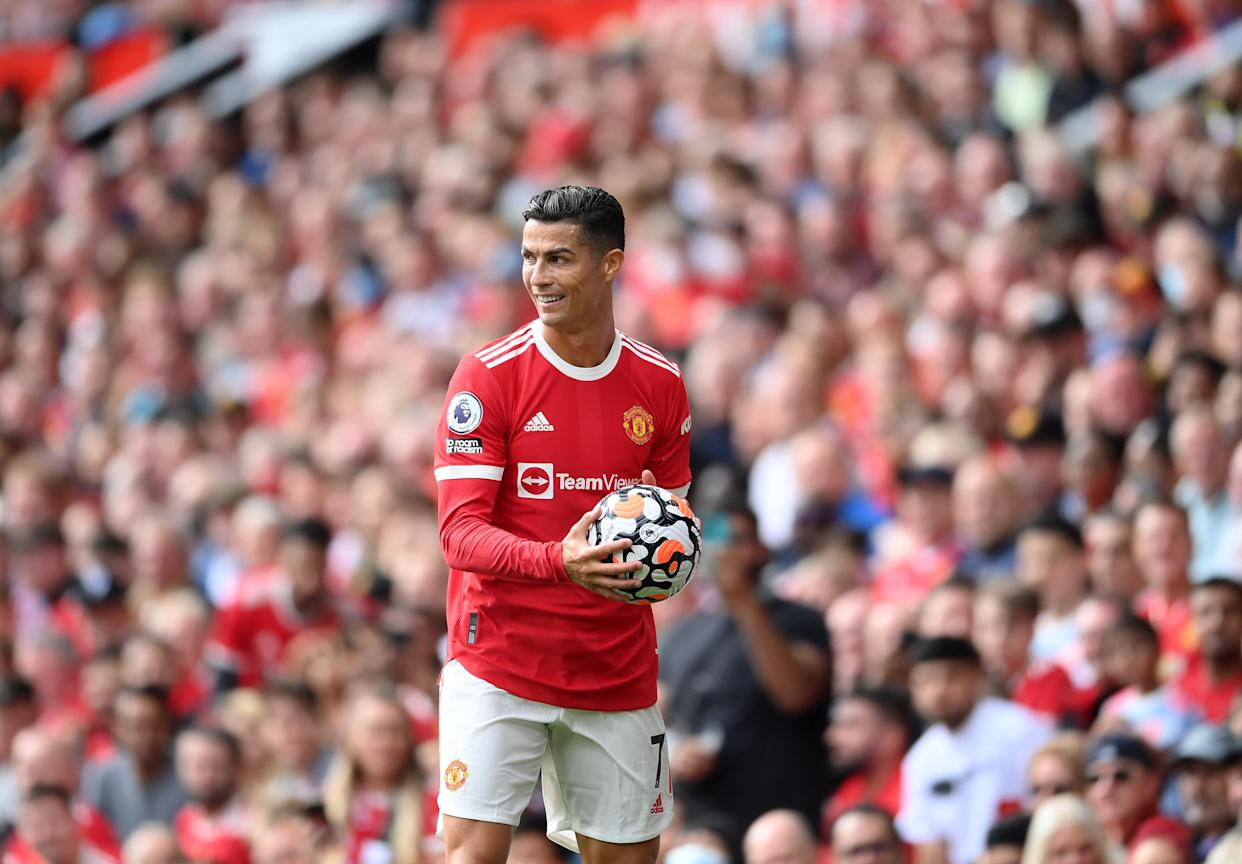 MANCHESTER, ENGLAND - SEPTEMBER 11: Cristiano Ronaldo of Manchester United smiles during the Premier League match between Manchester United and Newcastle United at Old Trafford on September 11, 2021 in Manchester, England. (Photo by Laurence Griffiths/Getty Images)