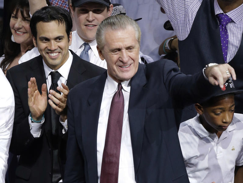 Miami Heat head coach Erik Spoelstra, left, and president Pat Riley celebrate after Game 7 of the NBA basketball championships, Friday, June 21, 2013, in Miami. The Miami Heat defeated the San Antonio Spurs 95-88 to win their second straight NBA championship.(AP Photo/Wilfredo Lee)