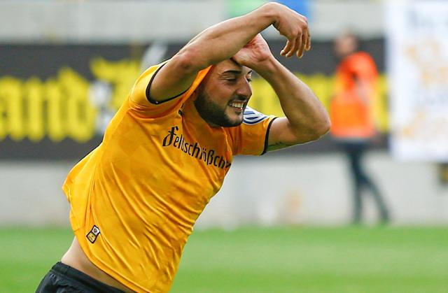 Football Soccer - Dynamo Dresden v RB Leipzig - German Cup (DFB Pokal) - DDV-Stadion, Dresden, Germany - 20/08/16. Dynamo Dresden's Aias Aosman reacts after he scored the final penalty. REUTERS/Axel Schmidt. DFB RULES PROHIBIT USE IN MMS SERVICES VIA HANDHELD DEVICES UNTIL TWO HOURS AFTER A MATCH AND ANY USAGE ON INTERNET OR ONLINE MEDIA SIMULATING VIDEO FOOTAGE DURING THE MATCH.