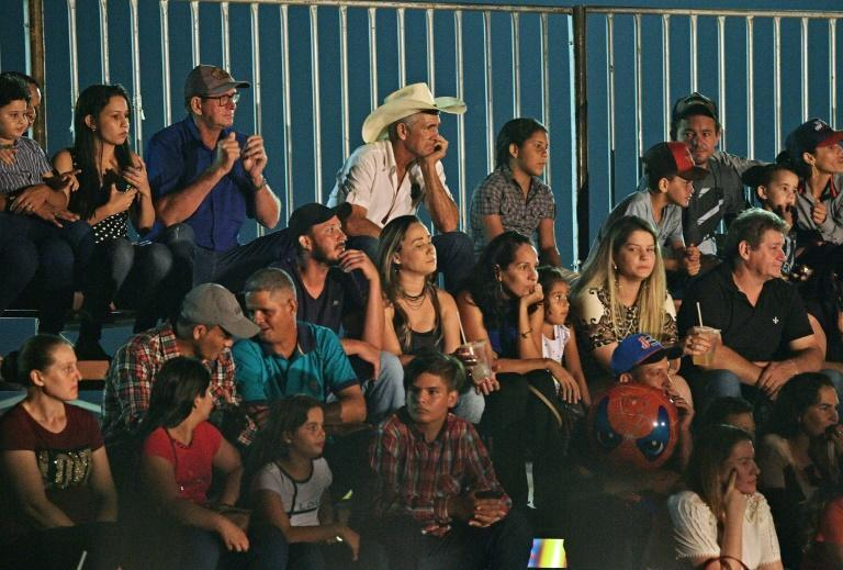Spectators attend a rodeo event in Monte Negro in Brazil's Rondonia state (AFP Photo/CARL DE SOUZA)