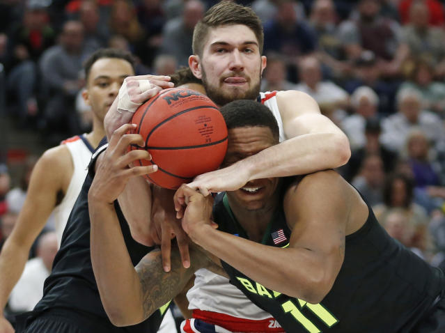 <p>Gonzaga forward Killian Tillie, rear, battles with Baylor guard Mark Vital (11) for a rebound during the first half of a second-round game in the NCAA men's college basketball tournament Saturday, March 23, 2019, in Salt Lake City. (AP Photo/Rick Bowmer) </p>