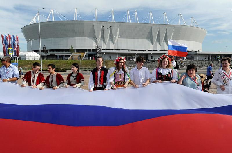 FILE PHOTO: People take part in the Day of Russia celebrations near the the Rostov Arena, which will host matches of the 2018 FIFA World Cup, in Rostov-on-Don, Russia June 12, 2018. REUTERS/Sergey Pivovarov/File Photo