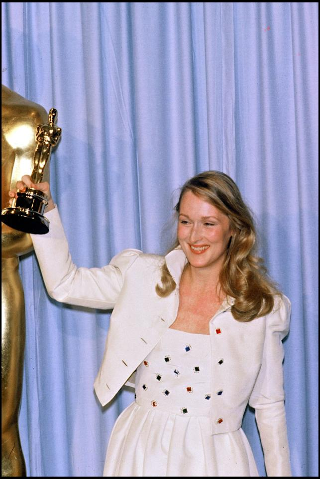 <p>In a cropped white jacket with a popped collar and a matching dress, Streep accepted her first Oscar for <i>Kramer vs. Kramer.</i></p>