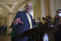 Senate Majority Leader Chuck Schumer, D-N.Y., speaks to reporters as intense negotiations continue to salvage a bipartisan infrastructure deal, at the Capitol in Washington, Tuesday, July 27, 2021. (AP Photo/J. Scott Applewhite)