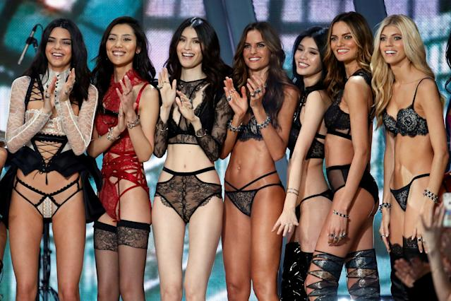 Models including Kendall Jenner, Izabel Goulart and Barbara Fialho applaud at the end of the 2016 Victoria's Secret Fashion Show. Photo: Getty Images