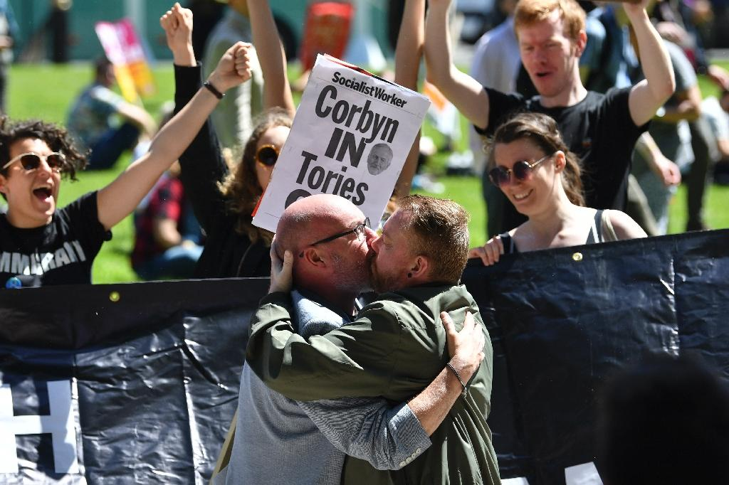 Men kiss at a protest in front of London's parliament against Prime Minister Theresa May's plans to govern with the support of the DUP, a party criticised for its opposition to gay marriage (AFP Photo/Justin TALLIS)