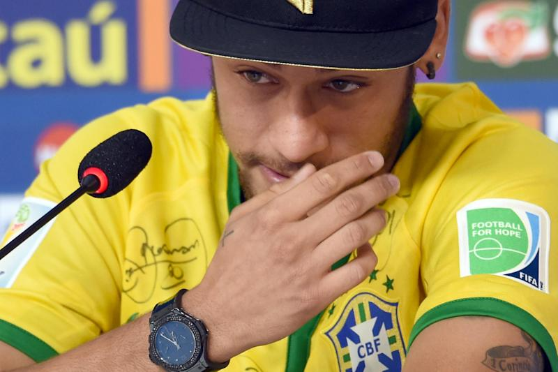 Brazil's star forward Neymar cries during a press conference in Teresopolis near Rio de Janeiro on July 10, 2014, during the 2014 FIFA World Cup