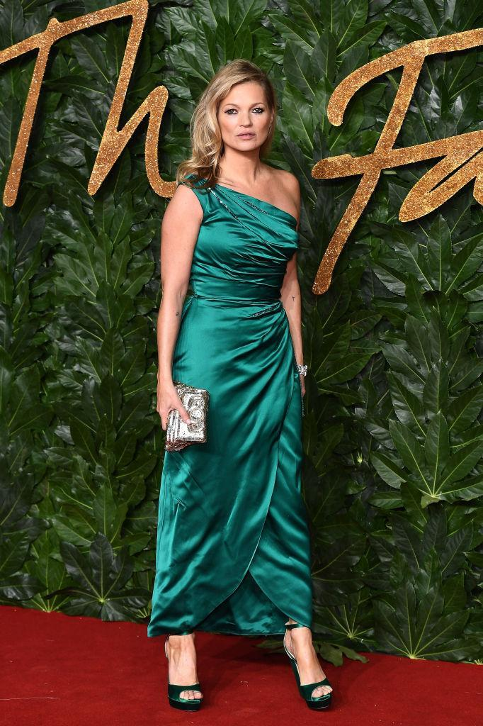 <p>Original super Kate Moss showed the fash pack how it's done in a emerald-hued dress complete with matching platforms. <em>[Photo: Getty]</em> </p>