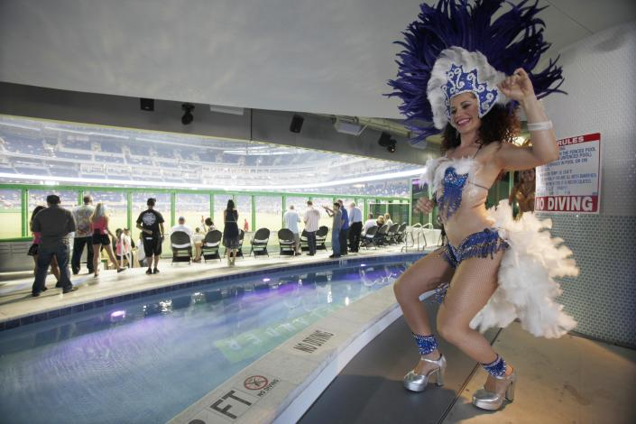A costumed dancer performs in front of the pool at Marlins Park before the Opening Day baseball game between the Miami Marlins and the St. Louis Cardinals, Wednesday, April 4, 2012, in Miami. (AP Photo/Wilfredo Lee)