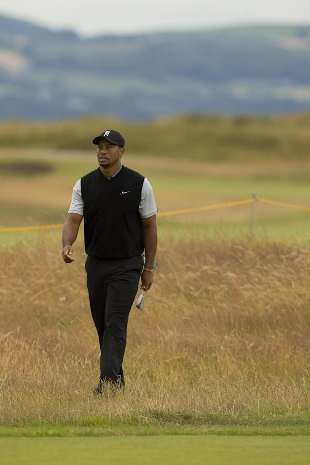 Tiger Woods of the US walks towards the 16th green during a practice round at Royal Liverpool Golf Club prior to the start of the British Open Golf Championship, in Hoylake, England, Saturday, July 12, 2014. The 2014 Open Championship starts on Thursday, July 17. (AP Photo/Jon Super)