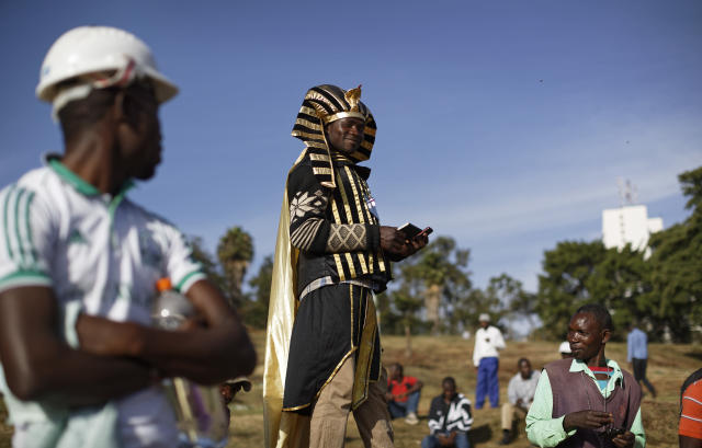 "<p>Supporters of opposition leader Raila Odinga, one wearing a Pharaoh costume, gather in advance of a mock ""swearing-in"" ceremony of Odinga at Uhuru Park in downtown Nairobi, Kenya Tuesday, Jan. 30, 2018. (Photo: Ben Curtis/AP) </p>"