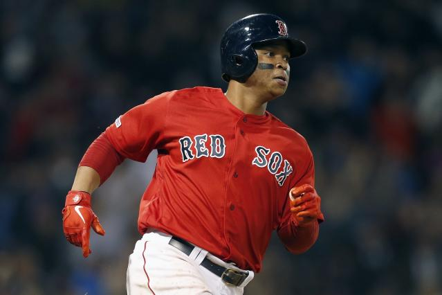 Boston Red Sox's Rafael Devers rounds first base on his solo home run during the fourth inning of the team's baseball game against the Seattle Mariners in Boston, Friday, May 10, 2019. (AP Photo/Michael Dwyer)