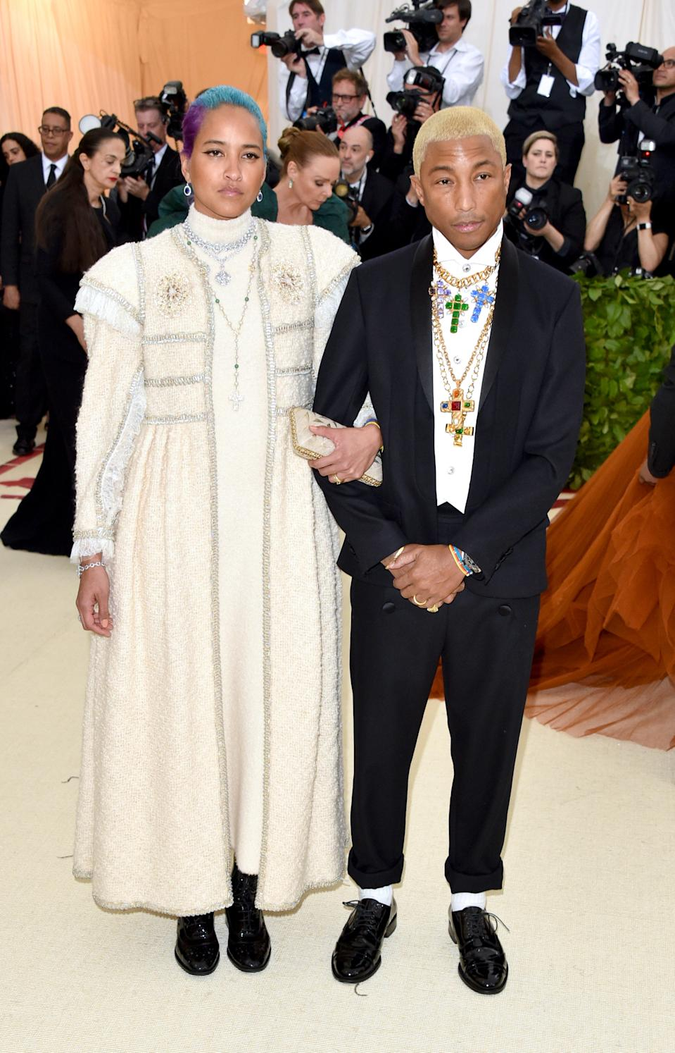 """<h1 class=""""title"""">Helen Lasichanh and Pharrell Williams in Chanel</h1><cite class=""""credit"""">Photo: Getty Images</cite>"""