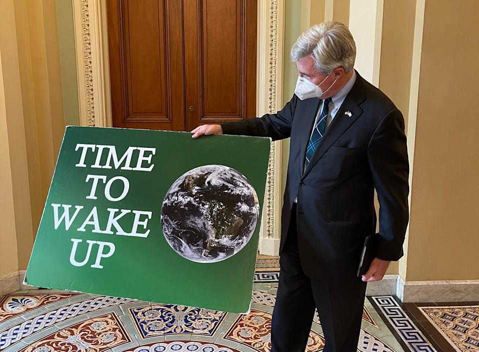 """""""Hope to God I won't need to bring it back out,"""" Sen. Sheldon Whitehouse said of his """"Time To Wake Up"""" sign. (Photo: )"""