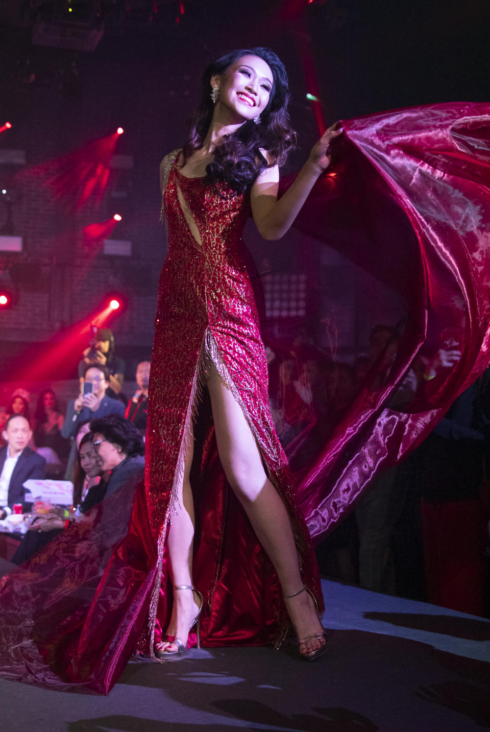 Lia Tan competing in the evening gown segment during the 2019 Miss Universe Singapore at Zouk.