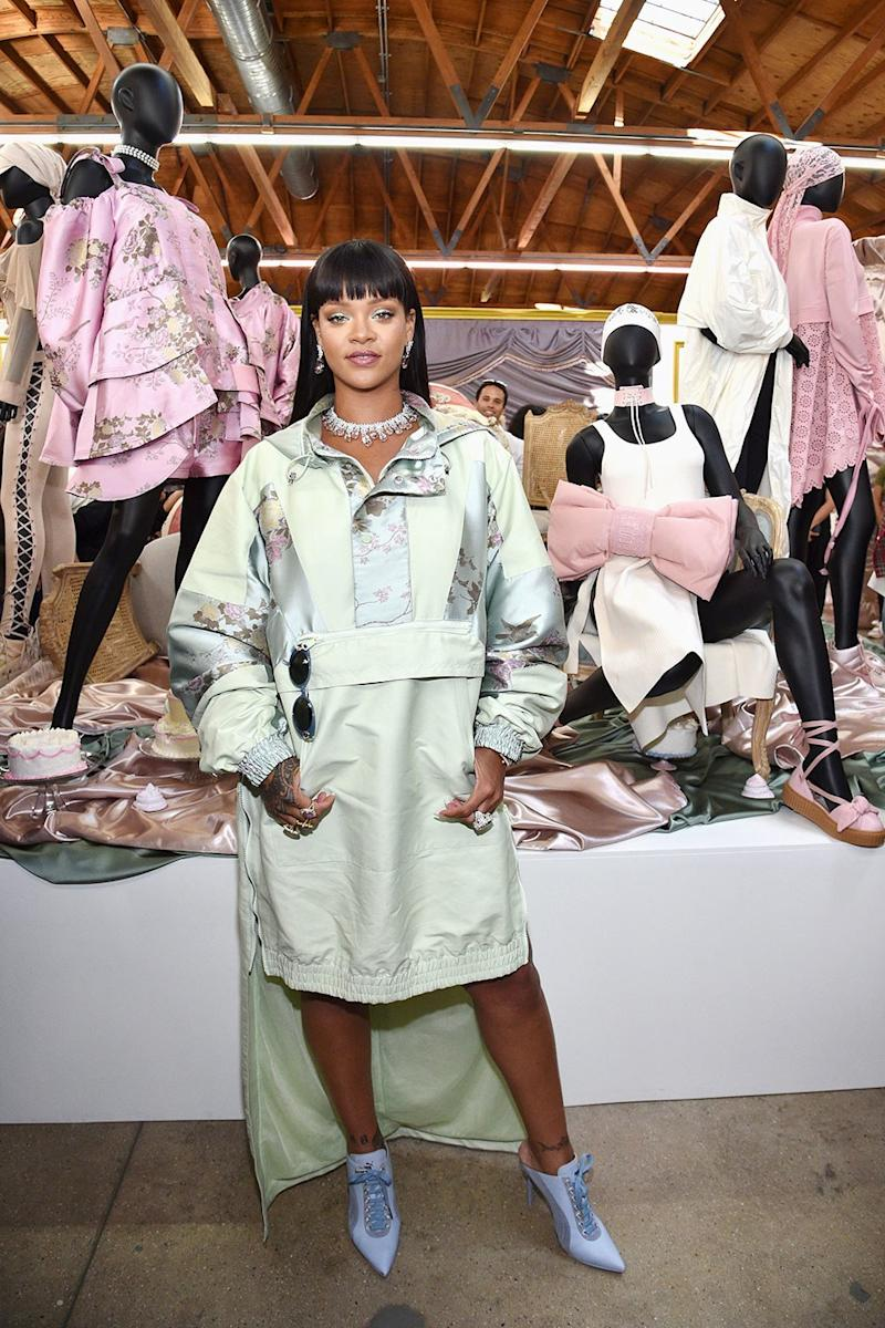 Rihanna wore a green satin parka from her Fenty x Puma spring collection while working at her pop-up shop in Los Angeles.