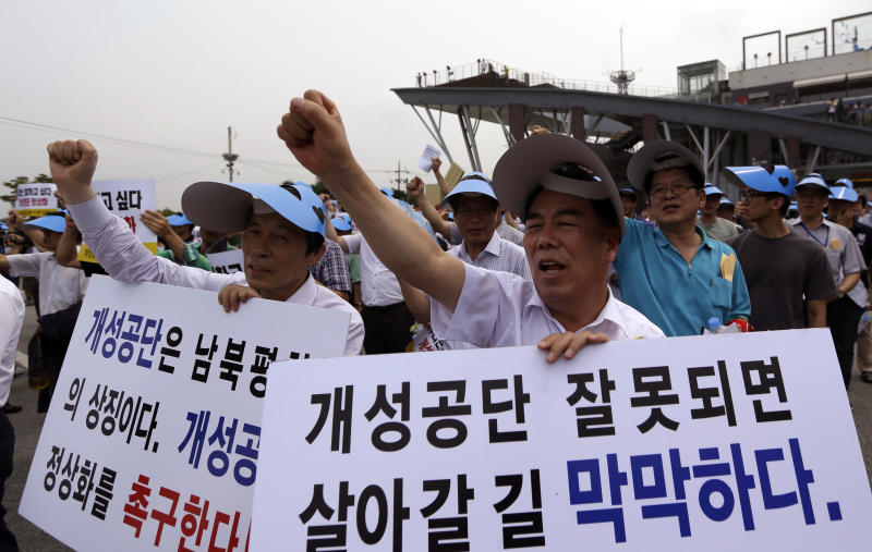 "South Korean owners who run factories in the stalled South Korea and North Korea's joint Kaesong industrial complex and workers shout slogans during a rally insisting the normalize the operation of the industrial complex at the Imjingak Pavilion near the border village of Panmunjom, which has separated the two Koreas since the Korean War, in Paju, north of Seoul, South Korea, Wednesday, Aug. 7, 2013. About 500 owners and workers gathered near the border area for the rally. The letter read ""Kaesong industrial complex is the symbol of two Koreas."" (AP Photo/Lee Jin-man)"