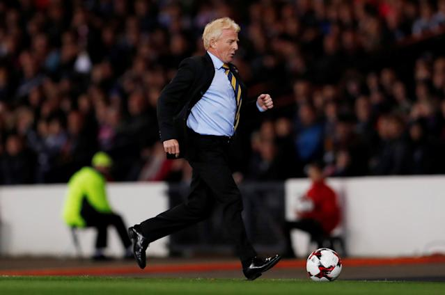 Soccer Football - 2018 World Cup Qualifications - Europe - Scotland vs Slovakia - Hampden Park, Glasgow, Britain - October 5, 2017 Scotland manager Gordon Strachan retrieves the ball Action Images via Reuters/Lee Smith