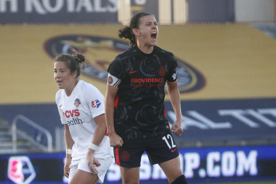Canadian star Christine Sinclair, seen here with the Portland Thorns during the NWSL Challenge Cup last summer, broke the record for most international goals scored by a man or woman. (AP Photo/Rick Bowmer)