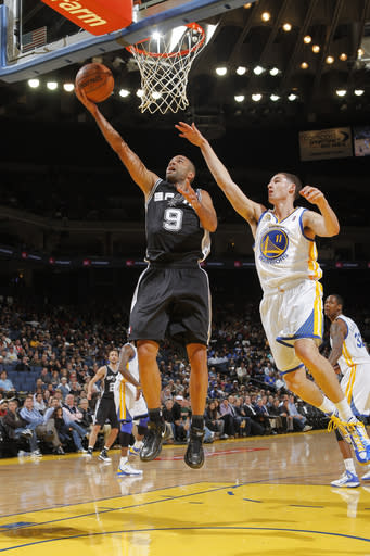 OAKLAND, CA - APRIL 16: Tony Parker #9 of the San Antonio Spurs lays the ball up against Klay Thompson #11 of the Golden State Warriors on April 16, 2012 at Oracle Arena in Oakland, California. (Photo by Rocky Widner/NBAE via Getty Images)