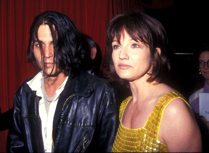 "Before his two-year relationship with Kate Moss, <a href=""http://voices.yahoo.com/johnny-depps-love-life-past-present-5708768.html"" data-ylk=""slk:Johnny Depp briefly dated Ellen Barkin in 1994;outcm:mb_qualified_link;_E:mb_qualified_link;ct:story;"" class=""link rapid-noclick-resp yahoo-link"">Johnny Depp briefly dated Ellen Barkin in 1994</a>."