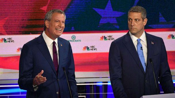 PHOTO: Mayor of New York City Bill de Blasio speaks as Tim Ryan looks on as they participate in the first Democratic primary debate hosted by NBC News at the Adrienne Arsht Center for the Performing Arts in Miami, Florida, June 26, 2019. (Jim Watson/AFP/Getty Images)