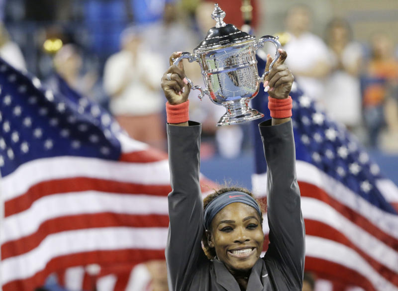 FILE - In this Sept. 8, 2013, file photo, Serena Williams, of the United States, holds up the championship trophy after defeating Victoria Azarenka, of Belarus, during the women's singles final of the U.S. Open tennis tournament in New York. Williams is The Associated Press' 2013 Female Athlete of the Year, easily winning a vote by news organizations. (AP Photo/David Goldman, File)