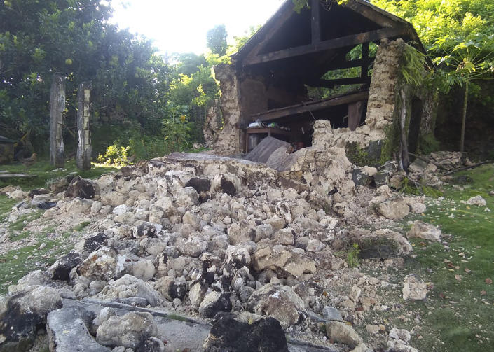 Damaged houses lie in Itbayat town, Batanes islands, northern Philippines following the earthquakes, Saturday, July 27, 2019. Two strong earthquakes hours apart struck a group of sparsely populated islands in the Luzon Strait in the northern Philippines early Saturday. (Agnes Salengua Nico via AP)