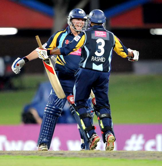PRETORIA, SOUTH AFRICA - OCTOBER 10: Gary Ballance and Adil Rashid of Yorkshire celebrate the win during the Karbonn Smart CLT20 pre-tournament Qualifying Stage match between Yorkshire (England) and Trinidad and Tobago (West Indies) at SuperSport Park on October 10, 2012 in Pretoria, South Africa.  (Photo by Lee Warren / Gallo Images / Getty Images)