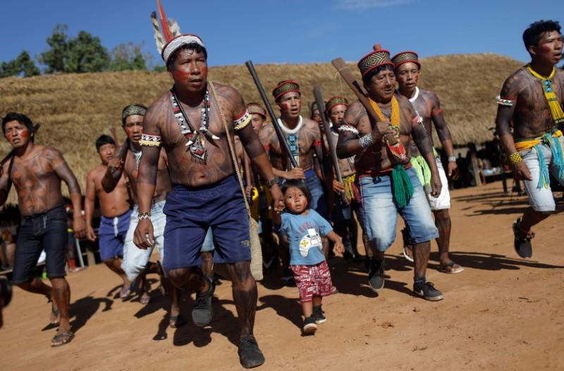 Indigenous people of Yudja tribe, perform a greeting dance during a four-day pow wow in Piaracu village, in Xingu Indigenous Park, near Sao Jose do Xingu, Mato Grosso state