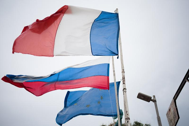 Russian, EU and French flags are seen at the entrance to the village of Pissa, not far from Berengo Palace, the former palace of the president Jean-Bedel Bokassa, which has been transformed into a military training camp