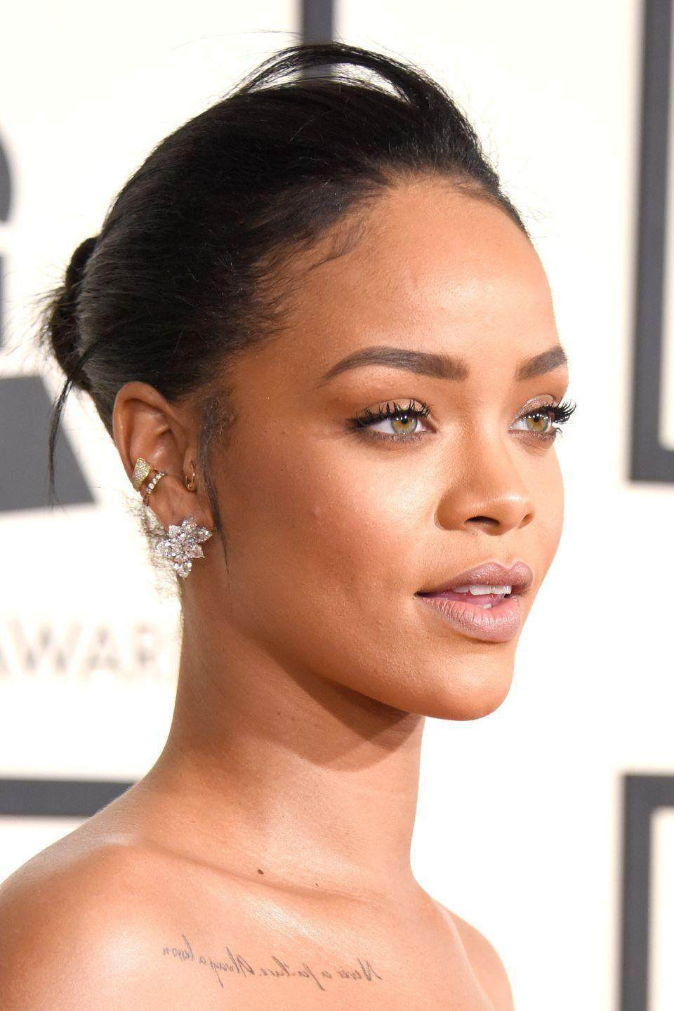 <p>Rihanna shows off two differing gold and diamond hoops in her outer conch piercings, which sit beautifully alongside the simple rose gold tragus hoop. </p>
