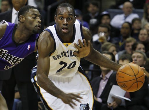 Sacramento Kings guard Tyreke Evans (13) tries to steal the ball from Memphis Grizzlies Quincy Poindexter (20) in the first half of an NBA basketball game on Tuesday, Jan. 3, 2012, in Memphis, Tenn. (AP Photo/Jim Weber)