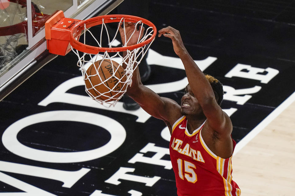Atlanta Hawks center Clint Capela scores during the first half of the team's NBA basketball game against the Brooklyn Nets on Wednesday, Jan. 27, 2021, in Atlanta. (AP Photo/Brynn Anderson)