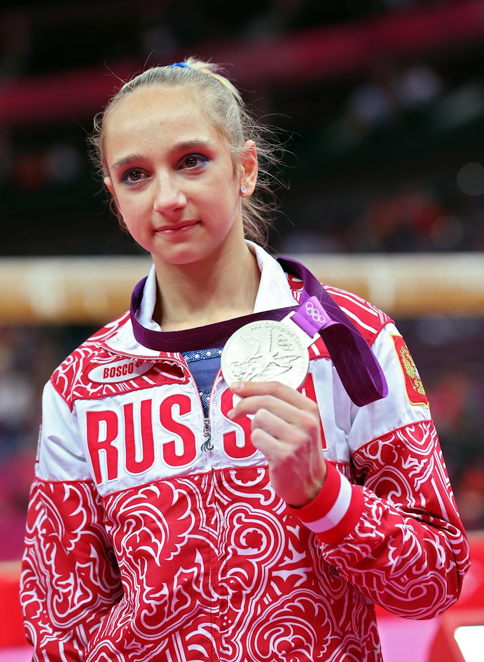 LONDON, ENGLAND - AUGUST 02: Victoria Komova of Russia poses with her silver medal after the Artistic Gymnastics Women's Individual All-Around final on Day 6 of the London 2012 Olympic Games at North Greenwich Arena on August 2, 2012 in London, England. (Photo by Ronald Martinez/Getty Images)