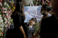 Edwin W. Edwards' wife Trina, left, and his son Eli, 7, speak with visitors as the former Louisiana Governor lies in state in Memorial Hall of the Louisiana State Capitol in Baton Rouge, La., Saturday, July 17, 2021. The colorful and controversial four-term governor died of a respiratory illness on Monday, July 12. (AP Photo/Michael DeMocker)