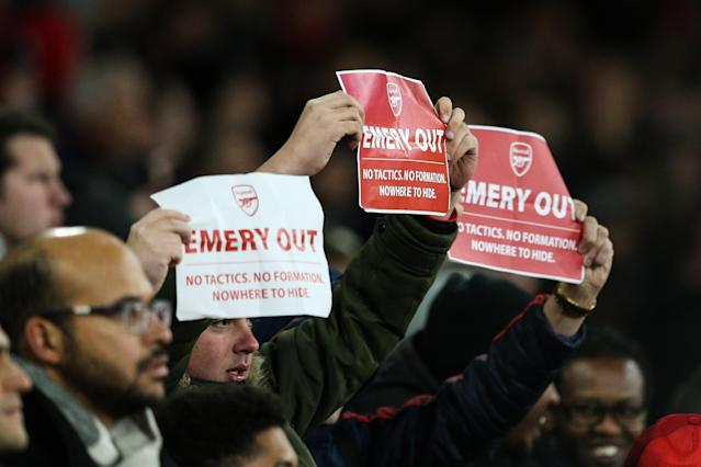 "Fans hold up ""Emery out"" signs after going behind (Photo by Craig Mercer/MB Media/Getty Images)"