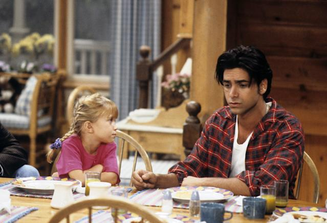 Mary Kate Olsen and John Stamos in the original series.  (ABC Photo Archives via Getty Images)