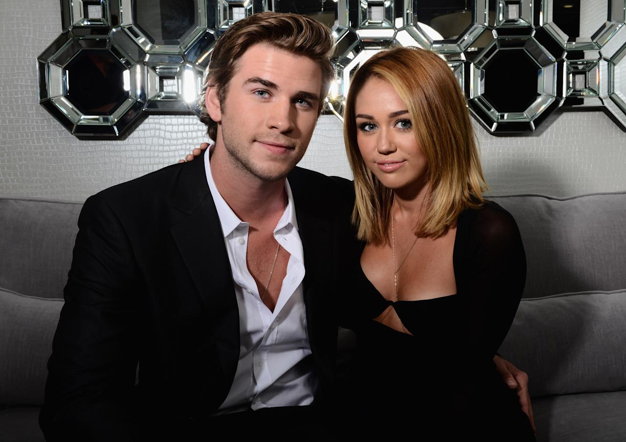 <p><b>Miley Cyrus</b> and <b>Liam Hemsworth</b> at an event last year. Simpler times! <br></p>