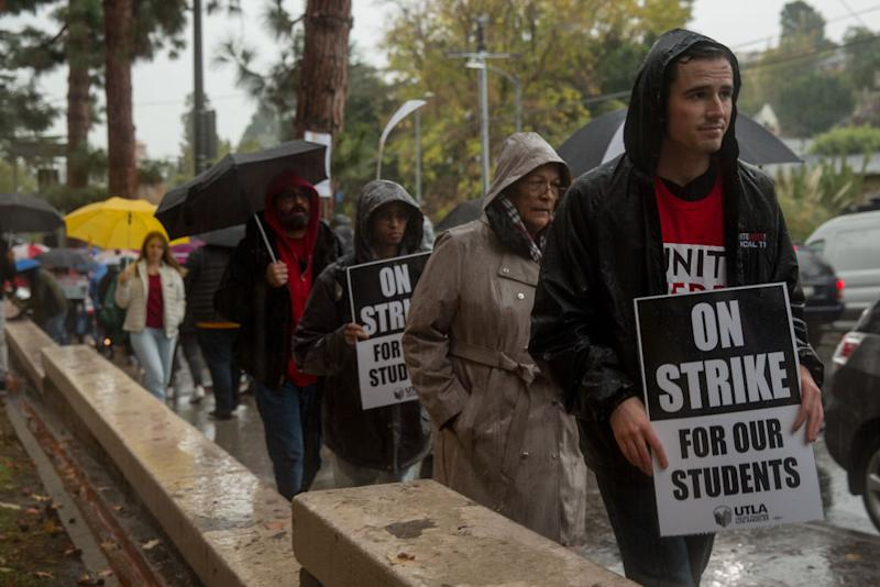 Teachers, students and supporters walk a picket line outside John Marshall High School in Los Angeles during a teachers strike spurred in part by public funding of charter schools, in January 2019. | Scott Heins—Bloomberg/Getty Images
