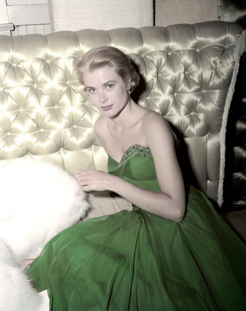 The actress-turned-royal wears a strapless green dress in this 1954 photo.