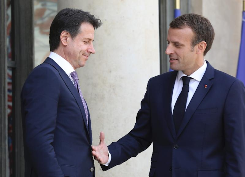 French President Emmanuel Macron welcomes new Italian Prime Minister Giuseppe Conte to the Elysee Palace in Paris ahead of talks on Friday (AFP Photo/LUDOVIC MARIN)