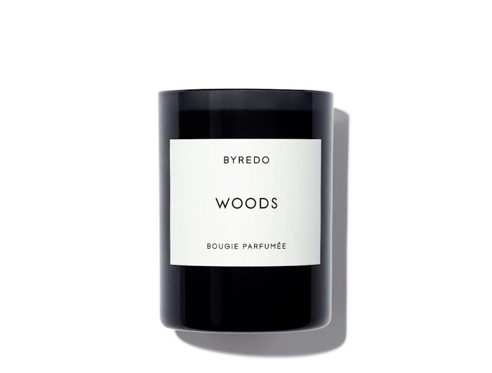 """<p><strong>Byredo</strong></p><p><strong>$85.00</strong></p><p><a href=""""https://go.redirectingat.com?id=74968X1596630&url=https%3A%2F%2Fwww.violetgrey.com%2Fproduct%2Fwoods-candle%2FBYR-20020015&sref=https%3A%2F%2Fwww.harpersbazaar.com%2Fbeauty%2Fg34078375%2Fbest-winter-candles%2F"""" rel=""""nofollow noopener"""" target=""""_blank"""" data-ylk=""""slk:Shop Now"""" class=""""link rapid-noclick-resp"""">Shop Now</a></p><p>""""I'm a big fan of most of Byredo's candles, but when it comes to channeling my favorite fall and winter vibes, I typically reach for this one. The smell reminds me of sitting around a roaring campfire in the actual woods, only better."""" —<em>Tiffany Dodson, associate beauty commerce editor</em></p><p><strong>Notes:</strong> raspberry, Tuscan leather, and white cedarwood</p>"""
