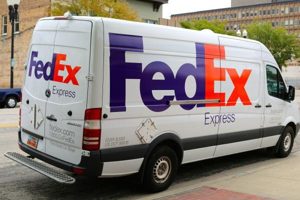 FedEx stock down 8% after company lowers outlook on trade tensions