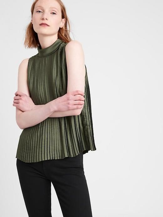 <p>This swingy, sleeveless <span>Banana Republic Satin Pleated Mock-Neck Top</span> ($70) will look super chic this spring.</p>